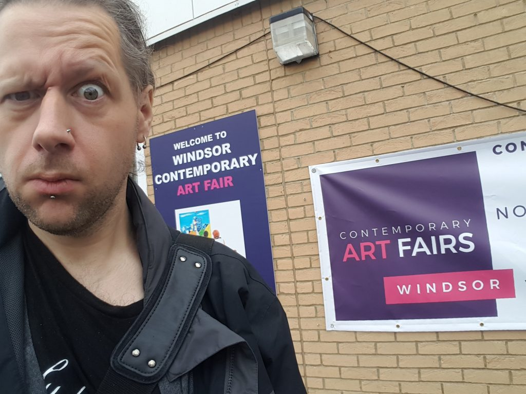 My face, my massive distorted face at an Art Fair